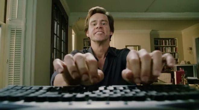 Jim Carrey, le dieu du clavier dans Bruce Tout Puissant